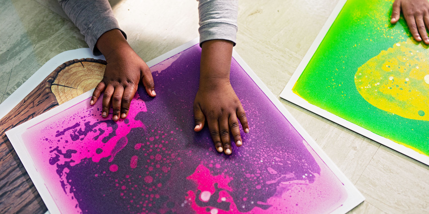 Student's hands working with sensory mats.