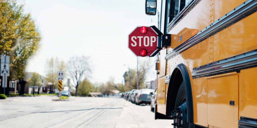 School bus stopped outside.